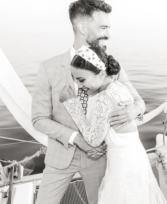 Interracial bride and groom boat wedding